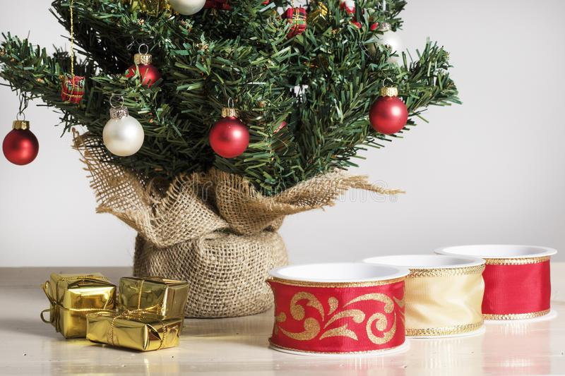 Ribbons, parcels and detail from a decorated Christmas Tree royalty free stock photography