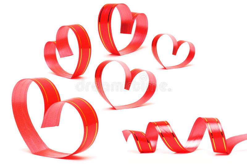 Ribbons shaped as hearts on white. Valentines day concept stock image