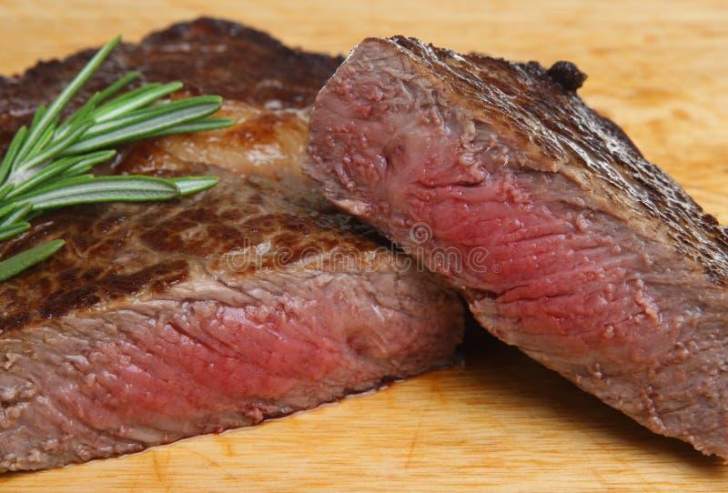 Ribeye Beef Steak. Cooked to medium rare royalty free stock photography