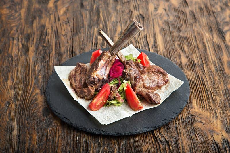 Ribeye steak on the bone royalty free stock images