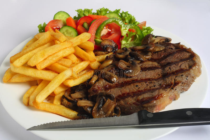 Ribeye steak dinner with knife stock photography