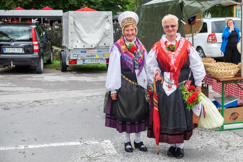 The traditional dressed women walks at holiday market in Ribnica town. Slovenia royalty free stock image