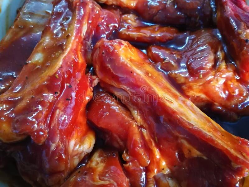 Ribs in marinade stock photo