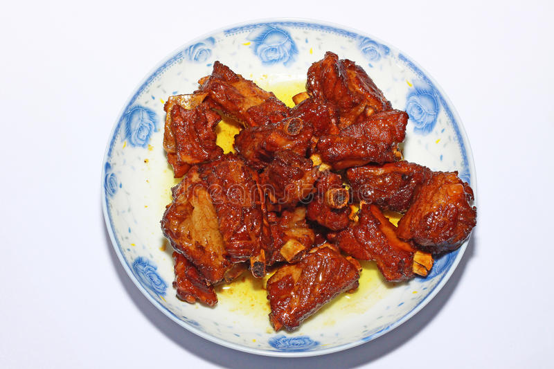 Ribs. The sweet and sour pork ribs on the plate royalty free stock photography