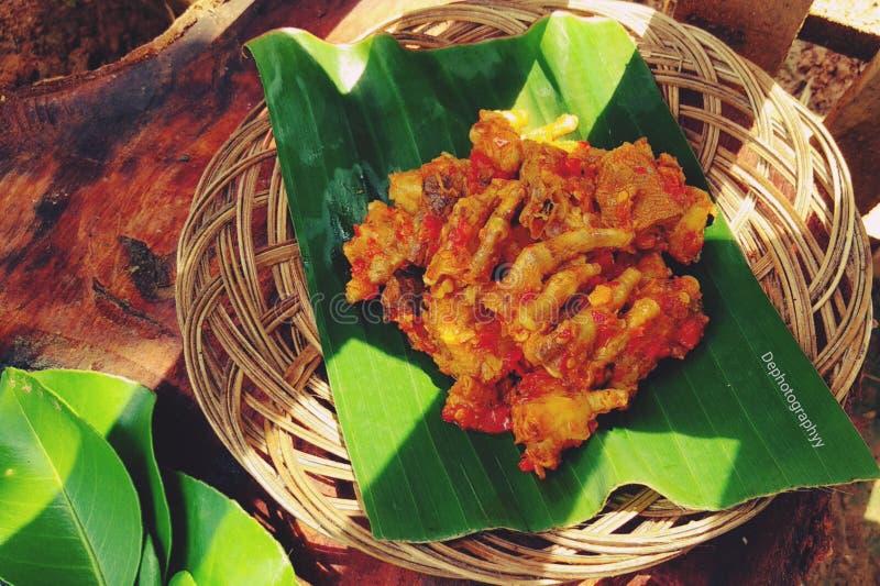 Rica-Rica Ayam es un menú de la comida que tiene un gusto picante, sabroso y dulce con el aroma de especias imagen de archivo