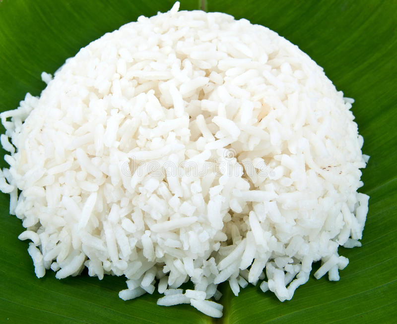 Rice. The white cooked rice on green leaf royalty free stock images
