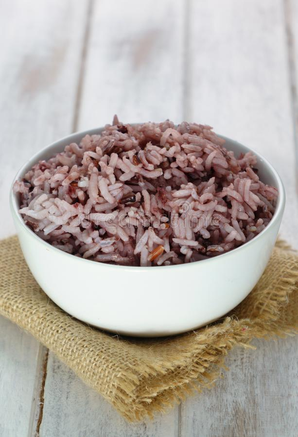 Rice berry in white bowl stock photo