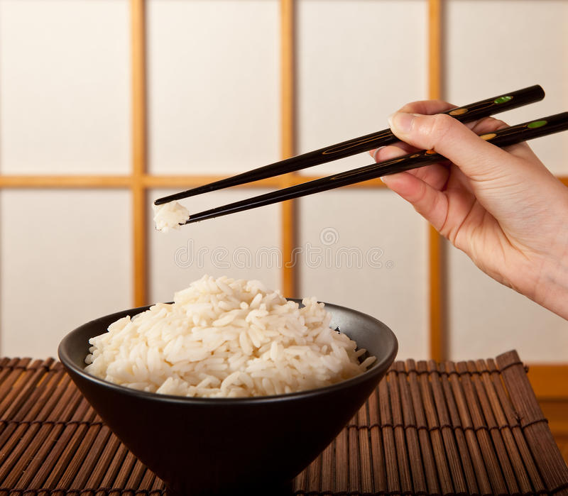 Rice bowl and chopsticks royalty free stock photos