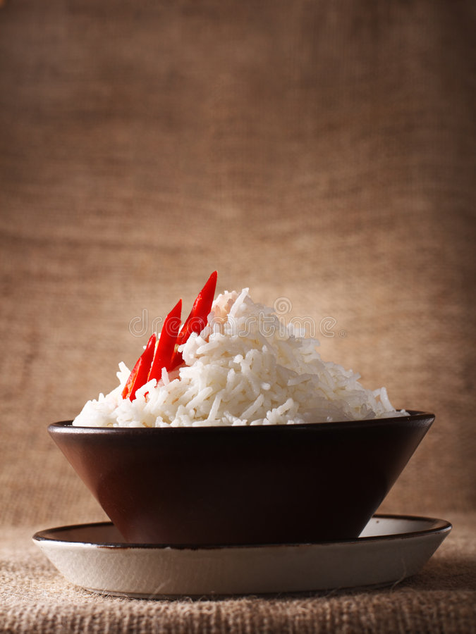Rice bowl with fresh chillies on rustic stock photos