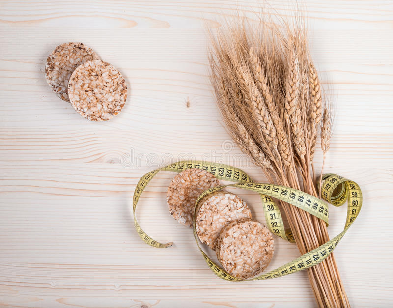 Rice cakes and wheat - healthy eating concept. Rice cakes and wheat on table - healthy eating concept stock photos