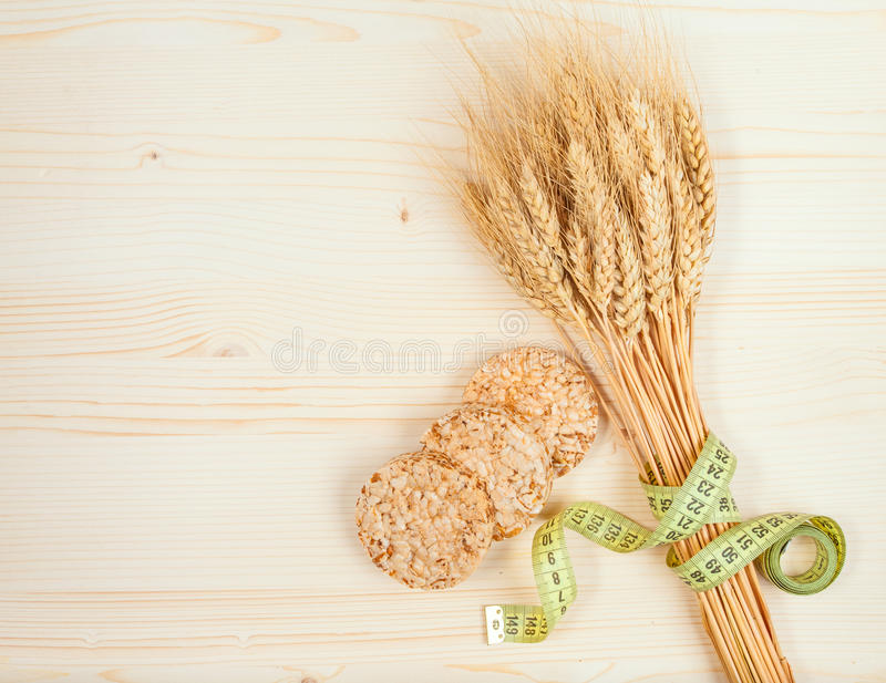 Rice cakes and wheat on table. Healthy eating concept stock photo