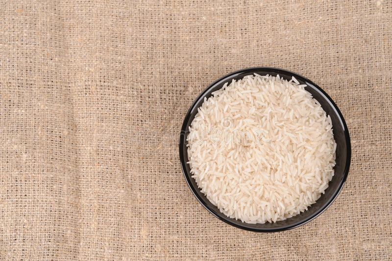 Rice on the canvas stock image