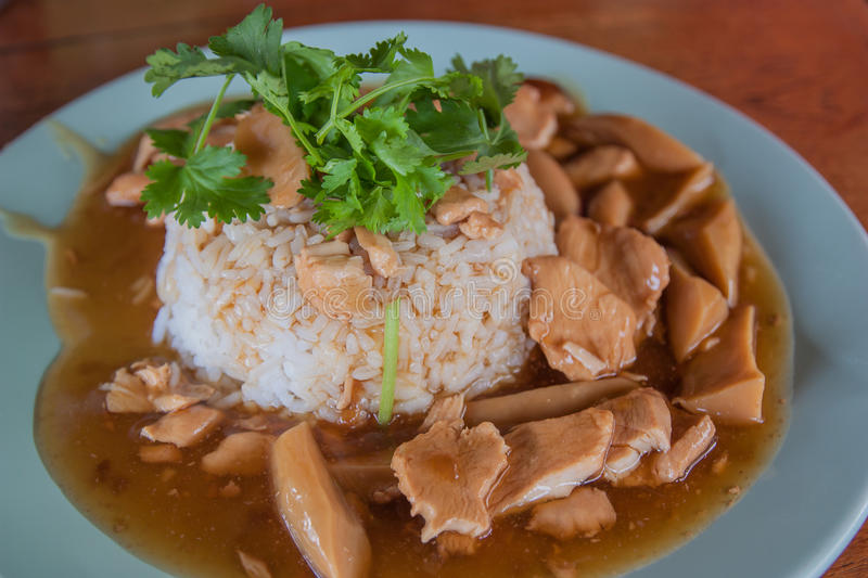 Rice chicken and mushroom with sauce over rice. stock photography