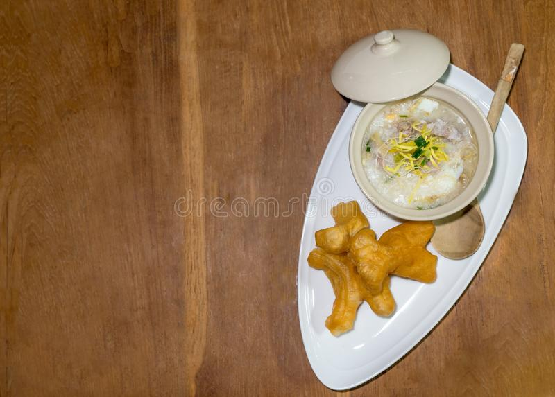 Rice congee in a small bowel with chinese doughnut pl stock photos