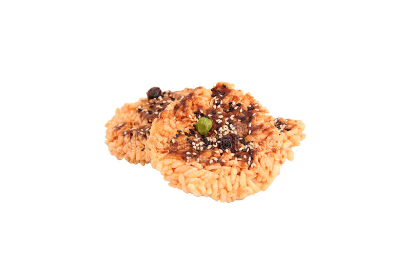 Rice Cracker. Fried rice topped with sugar liquid and sprinkled with whole grains stock image