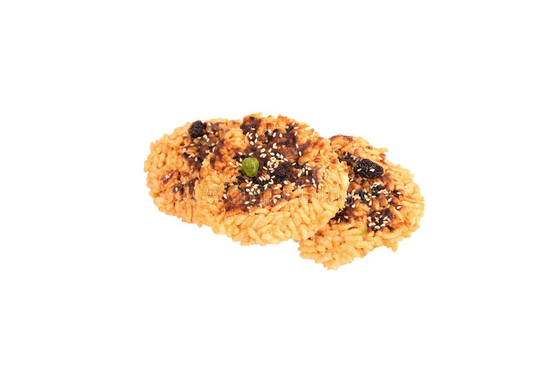 Rice Cracker. Fried rice topped with sugar liquid and sprinkled with whole grains royalty free stock image