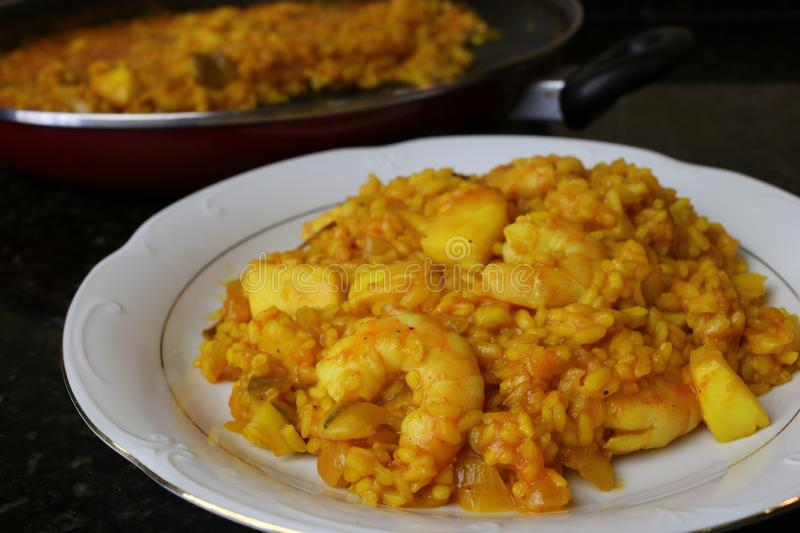 Rice with cuttlefish and prawns. The rice with cuttlefish and prawns is a very popular fish dish in Andalusia and Spain especially near the sea on the coast and stock photos
