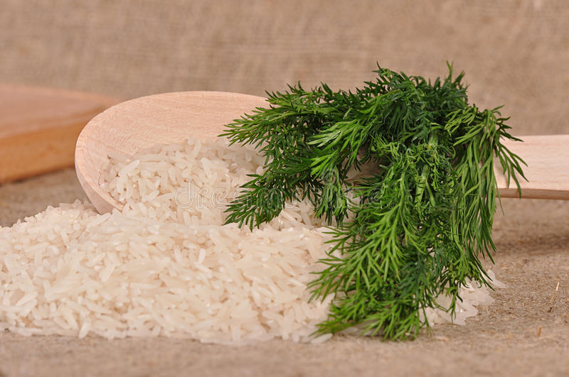 Rice with dill and spoon stock image