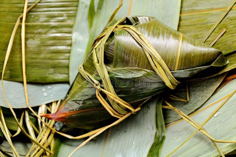 Rice dumpling on bamboo leaves stock image