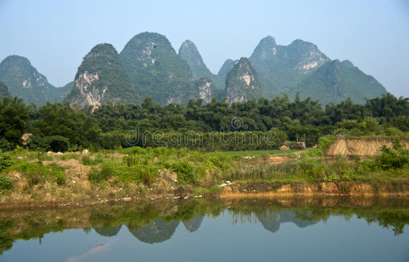 Rice Field in Yangshuo. With karst mountains reflection in the lake royalty free stock photos