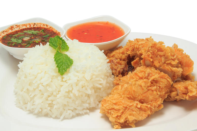 Rice with fried chicken and Thai style sauce and chili sauce royalty free stock image