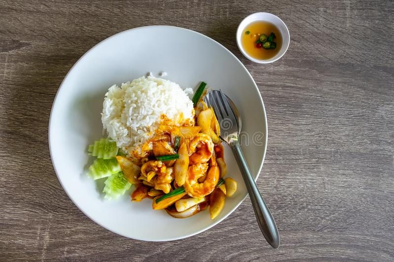 Rice with Fried Chilly Paste with Seafood, Shrimp and Squid on t stock photo