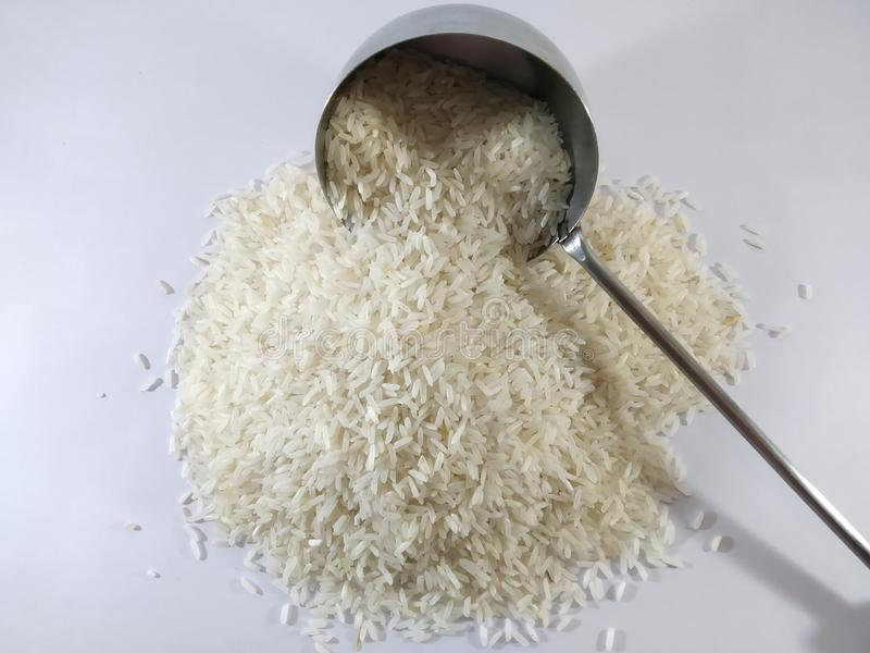 Rice Grain.Basmati rice on a pile isolated on white background. royalty free stock photography