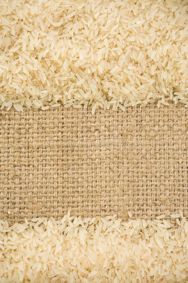 Rice grain and sack background stock photography