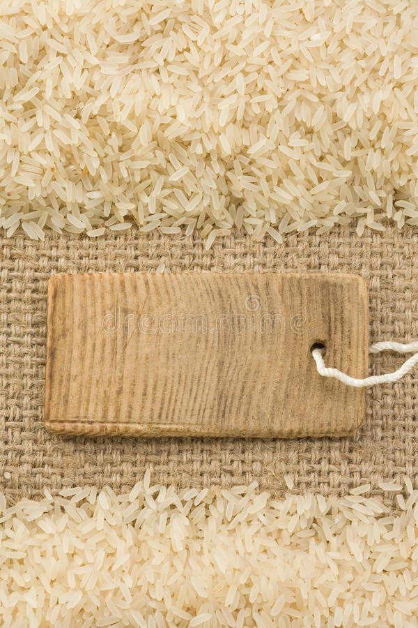 Rice grain and sack burlap as background stock photo