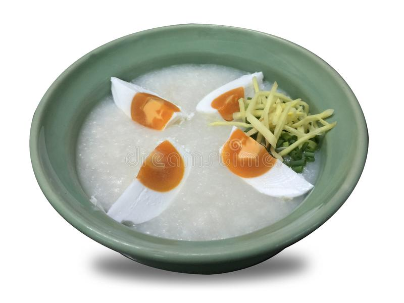 Rice gruel, rice soup on white background royalty free stock photo