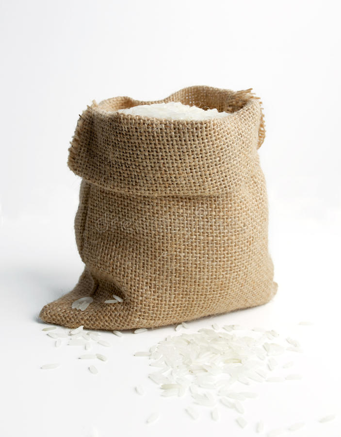 Rice i burlapsäck royaltyfria foton