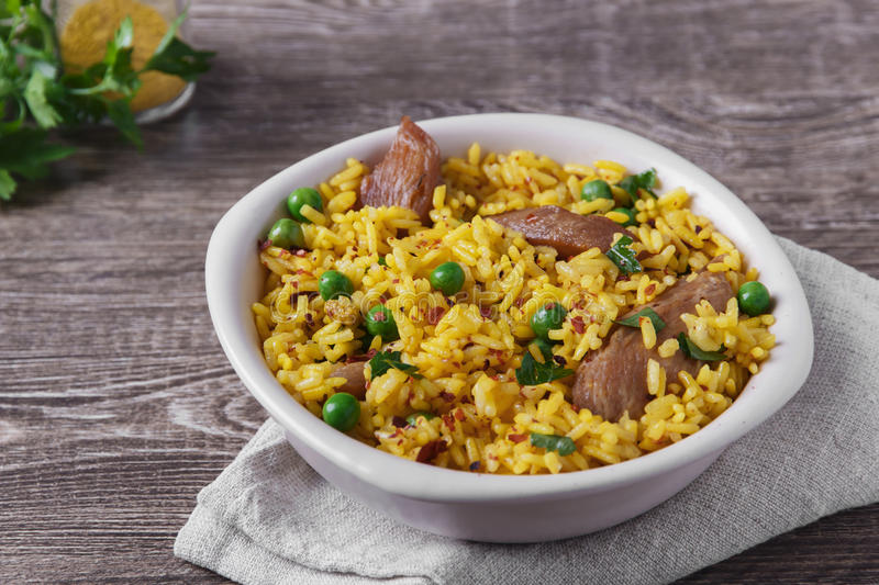 Rice with meat curry green peas cooked. Dish stock images