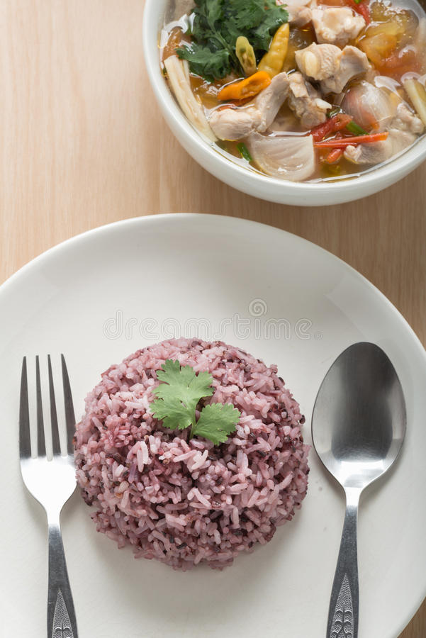 Rice mix purple rice berry rice with chicken soup. royalty free stock image