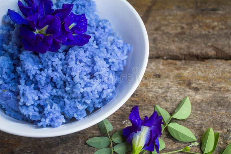 The rice mixed with pea flowers. The herb helps maintain strong roots. Steamed rice is mixed with a Clitoria ternatea is a good herb for the body stock photos