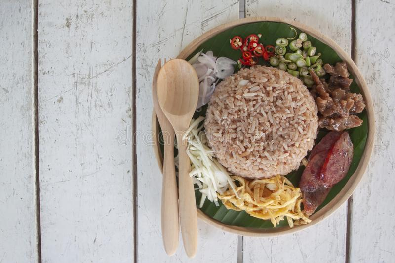 Rice mixed with shrimp paste Thai people call Kao Cluk Ka Pi. Rice mixed with shrimp paste Thai people call Kao Cluk Ka Pi on white wooden table royalty free stock photo