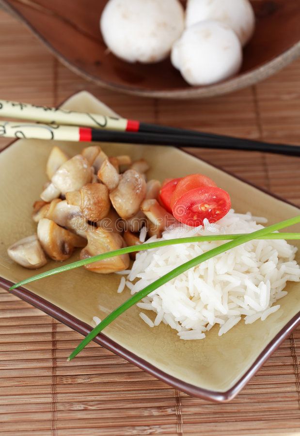 Rice, mushrooms and vegetable royalty free stock photo