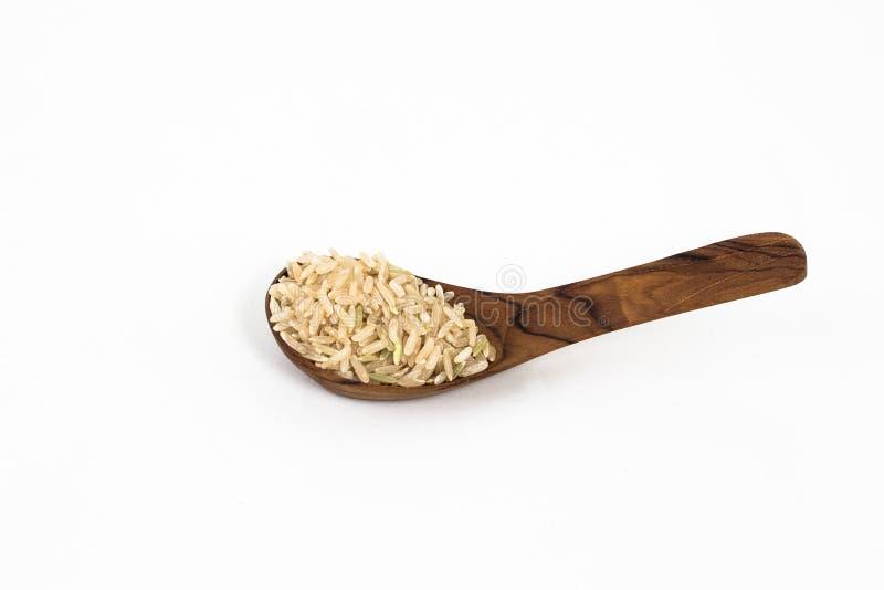 Rice na drewnianej łyżce zdjęcia stock