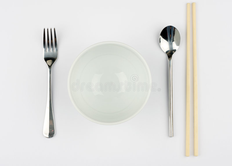 Rice and Noodle Bowl. Against a white tablecloth royalty free stock images