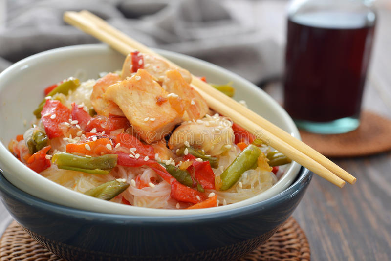 Rice noodles. With chicken and vegetables in bowl closeup royalty free stock photo