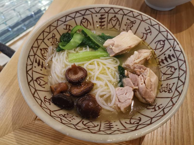 Rice noodles in mushrooms chicken soup style royalty free stock images