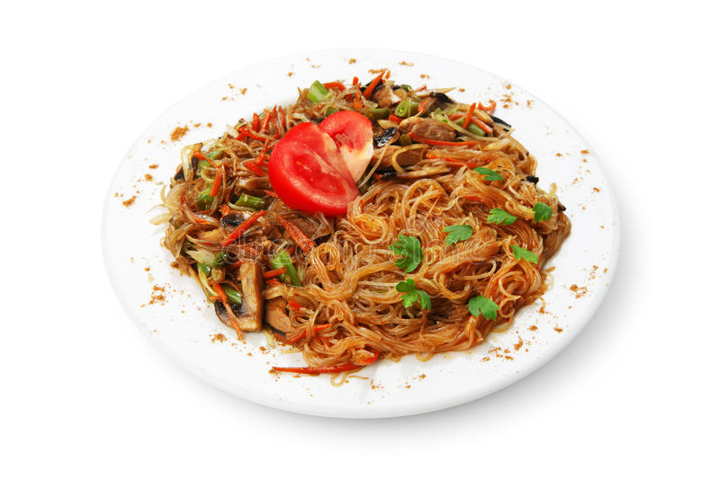 Rice noodles with shrimps and vegetables close-up on the table. top view of a horizontal stock images
