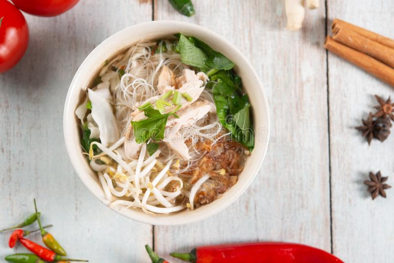 Rice noodles soup and chicken stock photos