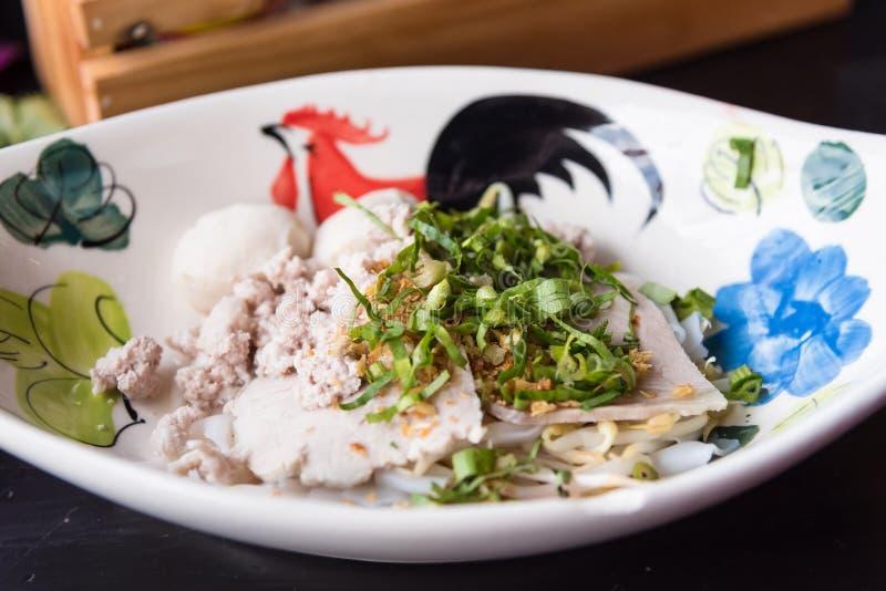 Rice noodles topping slice pork and entrails in soup on bowl. Rice noodles topping slice pork and entrails in soup on bowl stock photography