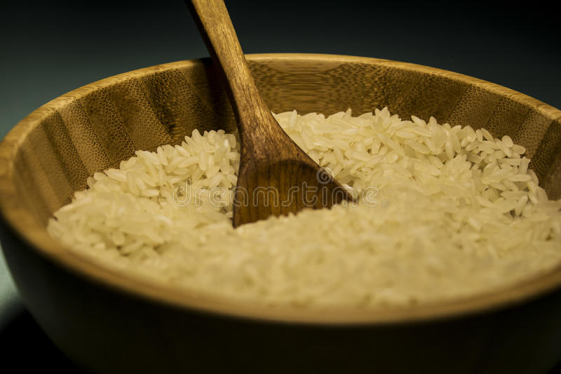Rice one. Spoon rise white cup wood royalty free stock images
