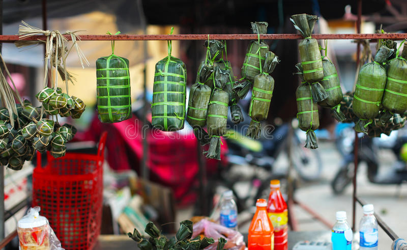 Rice parcels wrapped in banana leaves, Vietnam stock photos