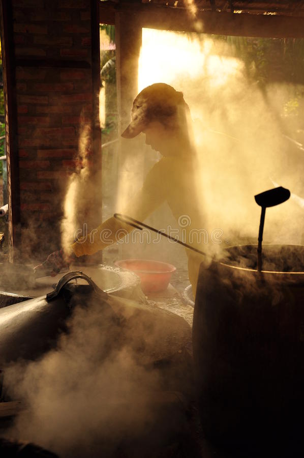 Man cooking rice paste for rice noodles, vietnam royalty free stock images