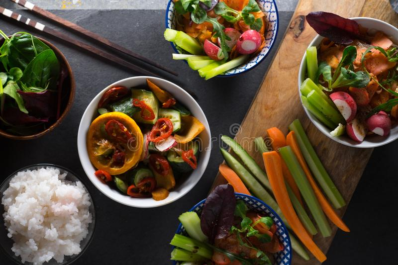 Rice, pickled vegetables in bowls and chopsticks close-up. Asian cuisine. Horizontal stock images