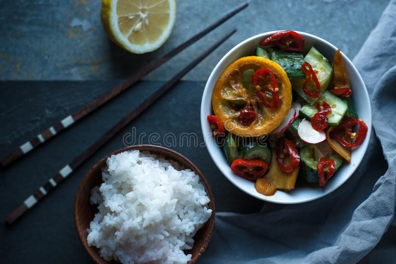 Rice, pickled vegetables and chopsticks. Asian cuisine. Horizontal royalty free stock photography
