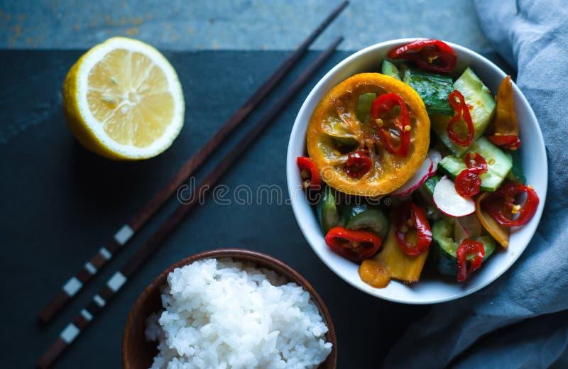 Rice, pickled vegetables and chopsticks closeup. Asian cuisine. Horizontal stock photos
