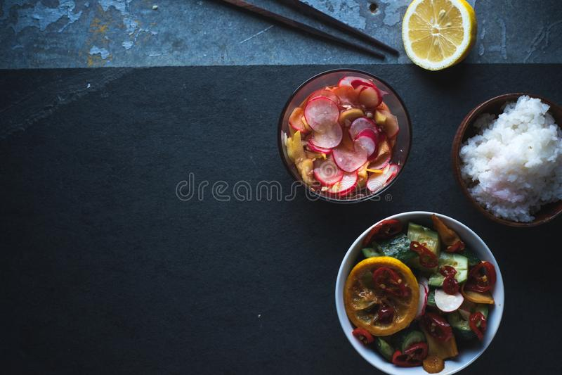 Rice, pickled vegetables, lemon and chopsticks on the right. Asian cuisine. Horizontal stock images